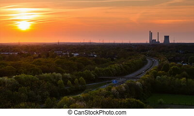 Coal Power Station And Motorway Sunset - Time lapse sequence...