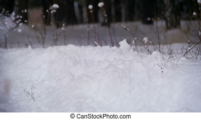 Man Running in the Deep Snow in the Winter Forest at Snowy...