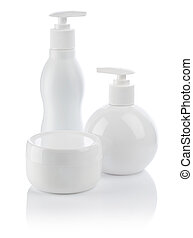 white cosmetical spray bottle and cream