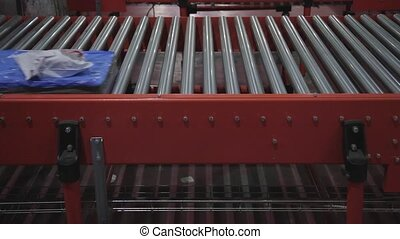 Package Conveyor - Shipping Packages at Conveyer Rollers in...