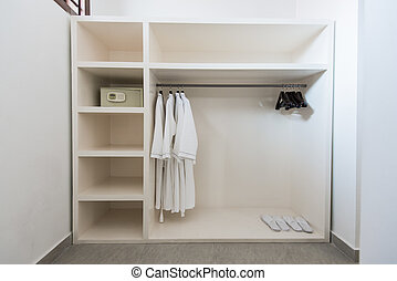 Bathrope, safe box and cloth hanger in wardrope
