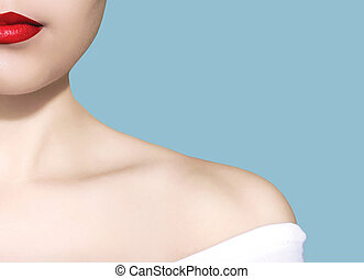 Beauty woman portrait white skin red lips closeup over blue...