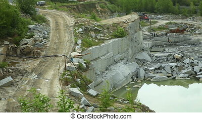 Quarry mining granite open-cast. Horizontal pan