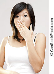 Unbelievable! - Shocked woman covering her mouth by hand.