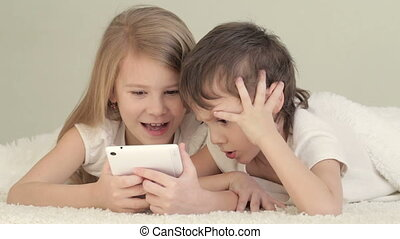 Little girl and boy using tablet - Little girl and boy on...