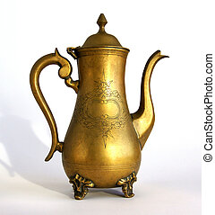 Antique brass coffeepot with a pattern on white background...