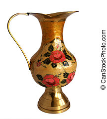 Antique brass jug with a flower pattern