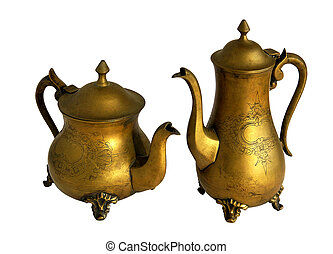Antique brass coffeepot and teapot with a pattern isolated...