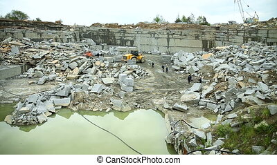 Workers in a stone quarry mining granite