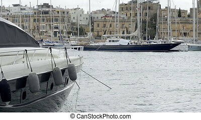 Yacht moored at Manoel Island Marina in Malta. View of  sail boats in a row on docks at seaside harbor.