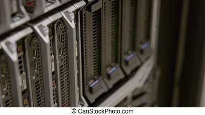 IT consultant power on a blade server in datacenter - IT...
