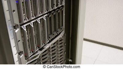 IT consultant repairing blade server in datacenter - It...