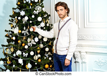 Christmas Eve - Christmas concept, male fashion. Handsome...