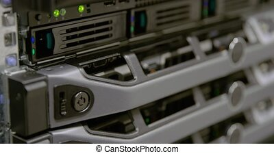 IT consultant power on a rack server in datacenter - IT...