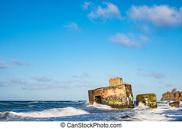 Bunker on shore of the Baltic Sea on a stormy day.