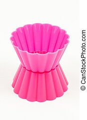 Pink silicone cake cups isolated on white background