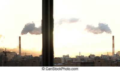 Morning in urban city. St. Petersburg. From pipe goes smoke. construction site cranes are working. Russia