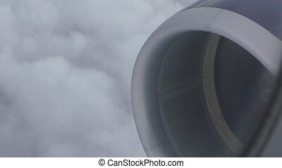 Aircraft above clouds turbine view - Close up of spinning...