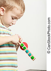 Little boy play with colorful toy. - Spending free time play...
