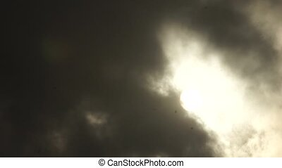 Clouds in the sky around the sun. - Dramatic clouds in the...