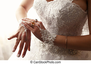 The  bride weared a  wedding dress and gloves