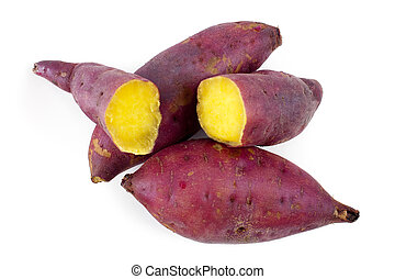 Sweet potatoes - Cooked whole and halved sweet potatoes on...