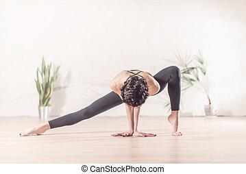 Fit modern dancer standing gracefully on tiptoe in wide side...
