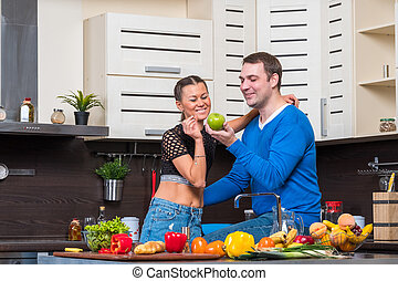 Young couple having fun in the kitchen