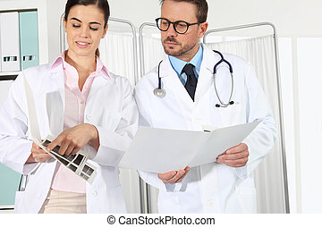 doctors with medical records, concept of  consulting