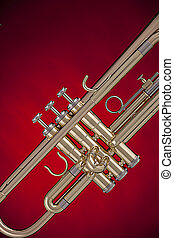 Gold Trumpet Isolated On Red - A gold professional trumpet...