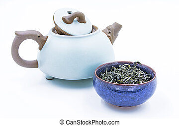 Chinese Green tea. (Huang Shan Mao Feng) in a blue ceramic...