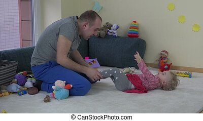 Man tickle toddler girl. - joyful father have fun with baby...