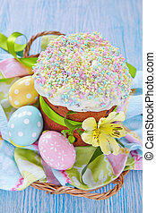 Easter cake and colorful eggs on table