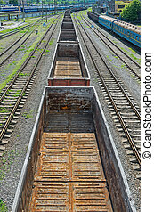 Empty freight wagons - View of a moving railway freight...