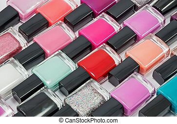 Nail polish - Multi-colored bottles with nail polish laid...