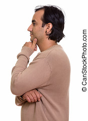 Profile view of Persian man thinking