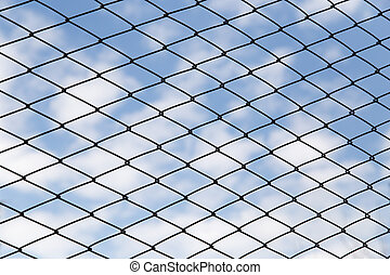 metal fence against the blue sky with clouds