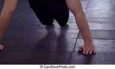 Man does push ups on the floor - Strong sportsman doing push...