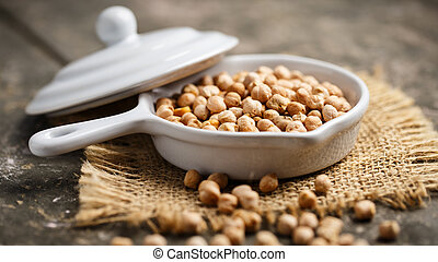 chickpeas - Dried chickpeas in a small bowl on a rustic...