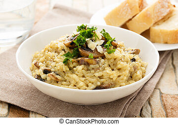 Risotto ai funghi - risotto with mushrooms, fresh herbs and...