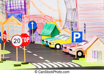 Models of paper cars at the parking in toy city - Models of...