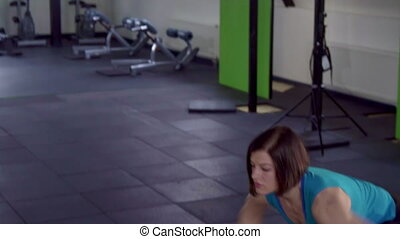 Fitness woman does crossfit exercise - Pretty fitness woman...