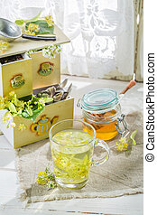 Fresh tea with honey in spring day