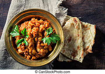 Indian Channa Masala with chickpeas and Naan bread