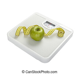 scale libra measurement tape diet fruit food apple - close...
