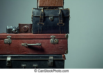 Stack of vintage shabby suitcases. Background Traveller...