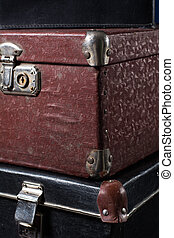 Close-up of a stack vintage shabby suitcases - Close-up of a...