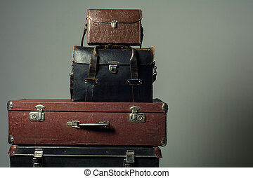 Background stack of old suitcases form a tower. The concept...