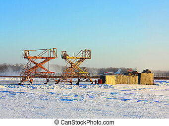 Military airfield in winter - Airfield equipment for repair...