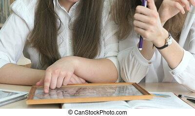 Two girls looking at photo frame with the photo - Two girls...